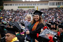 Chante Catt standing for her 2018 graduation. - SAM ARMANINO
