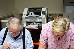 Volunteers Wes Rishel and Carolyn Crnich scan ballots for the Elections Transparency Project. - PHOTO BY THADEUS GREENSON