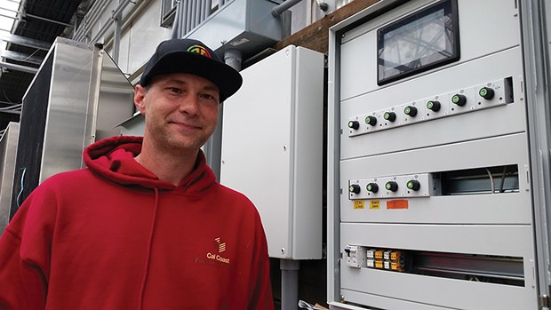 Bryan Robinson of Riverbar Pharms and his canna computer.
