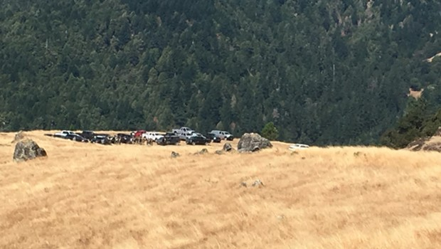 A law enforcement convoy gathers in Salmon Creek, preparing to serve search warrants Aug. 5.