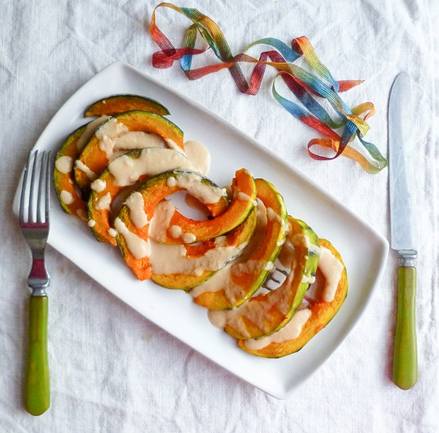 Roasted winter squash with tahini dressing.