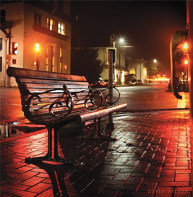The empty bench on the corner of Fourth and E streets.