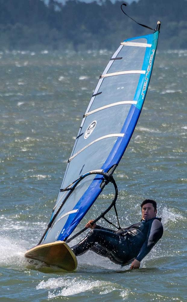 Bohdi Portugal created some serious speed while wind surfing in high winds blowing across Humboldt Bay.