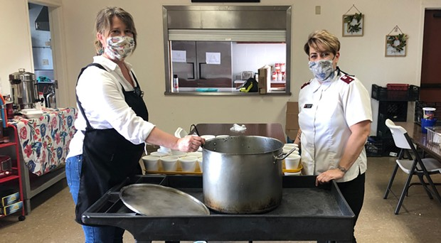 Christine Silver and Loretta Scott ladle out soup for seniors at the Silvercrest Residence.