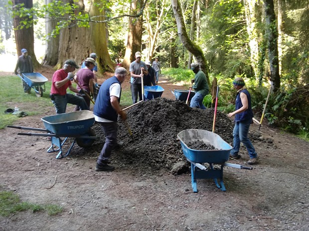 Volunteer trail stewards pitch in during an April work day.