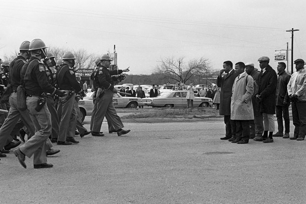 A young, trench coated John Lewis getting in trouble. Rest in power.