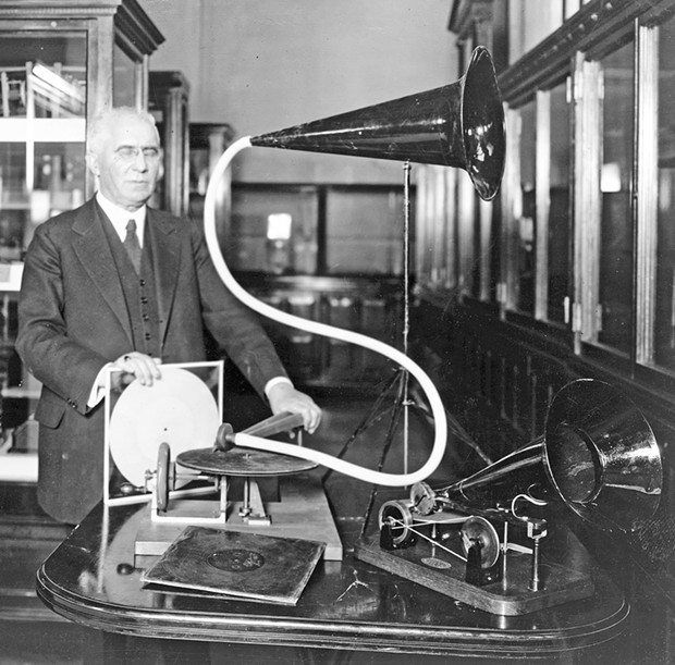 Emile Berliner (1851-1929) with a pair of his inventions, including the 1888 Gramophone (on right), circa 1920.