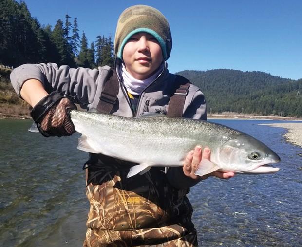 Tyler Bishop, of Eureka, holds a nice steelhead caughtMondayon the Eel River.