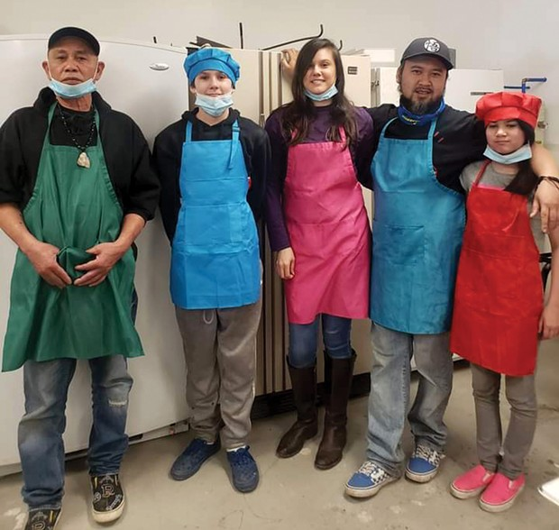 Left to right: Sone Phetsouphanh, Samuel Eugene and Amanda Young Phetsouphanh, and Nathan and Sophia Phetsouphanh in the Trading Post kitchen.
