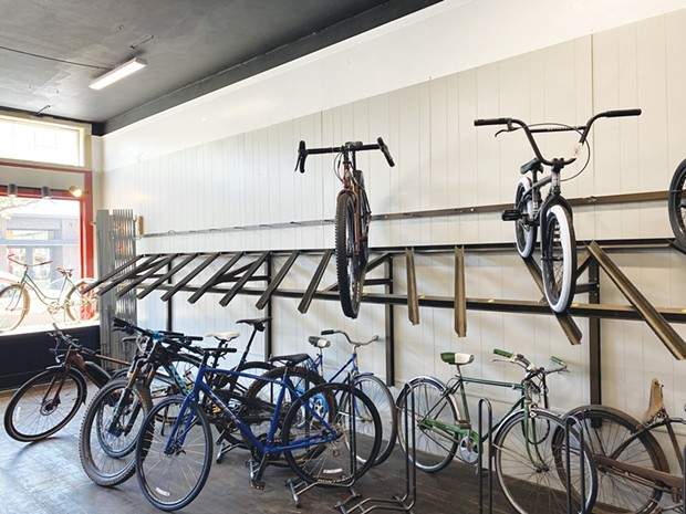 Empty bike racks at Revolution Bicycles in Eureka.