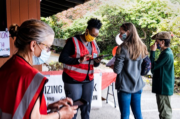 Nurses working with SnapNurse, an organization at the center of California's vaccination effort, sign in a couple of fair participants. The fair on Sunday, June 13, brought families from around the county for a chance to get vaccinated against COVID-19