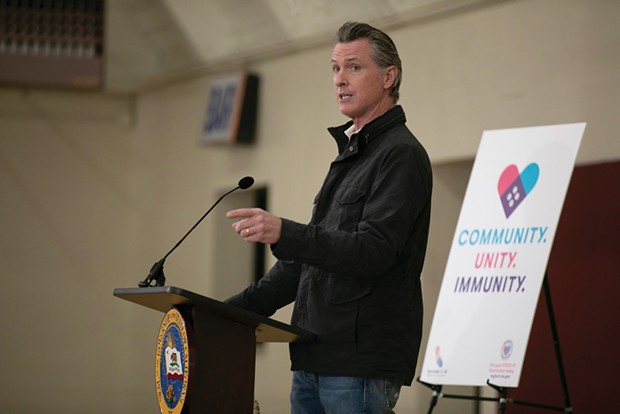 California Gov. Gavin Newsom, pictured at a press conference in April, announced July 26 that state employees and healthcare workers must be vaccinated or undergo weekly testing and wear masks while at work.