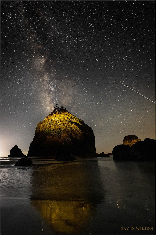 The one that got away. A large meteor streaks off the edge of the frame off the coast of Houda Beach. I had it by the tail! The truth of the matter is that this is cropped in from the left edge; for some reason I had the great rock centered. If I had composed it the way I knew I should have at the time, the entire meteor would have been included. This is why my hair is gray. Sept. 10, 2021, in Humboldt County, California.