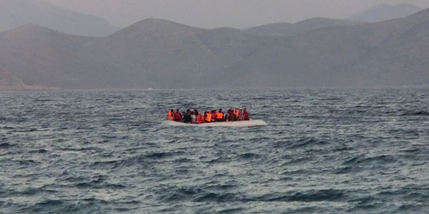 A rubber boat carrying around 50 refugees arrives from Bodrum in Turkey to the Greek island of Kos.