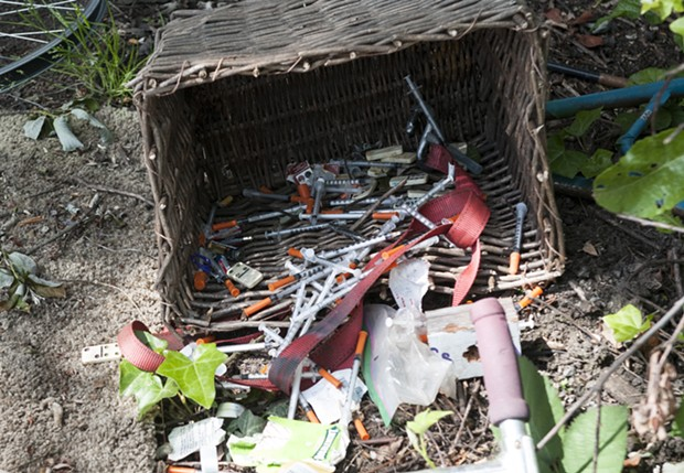 Needles discarded in a homeless camp.