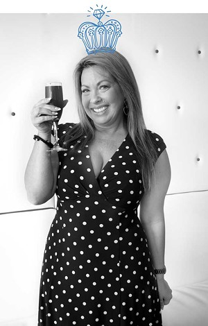 Owner Charity Desbrow sips a dragon fruit mimosa from the Green Lily, voted Best Mimosas. - AMY WALDRIP.