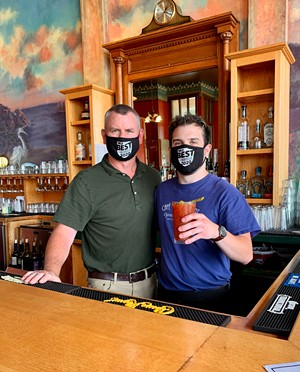 Café Waterfront owner Ben Smith and his son Henry raise this year's Best Bloody Mary. - SUBMITTED