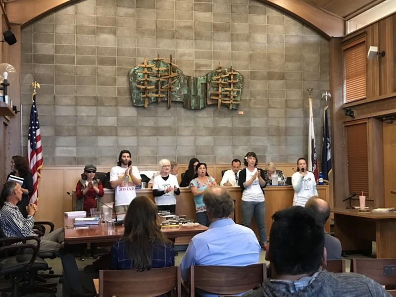 Protesters disrupt Thursday's Arcata City Council meeting. - CARMEN PENA-GUTIERREZ