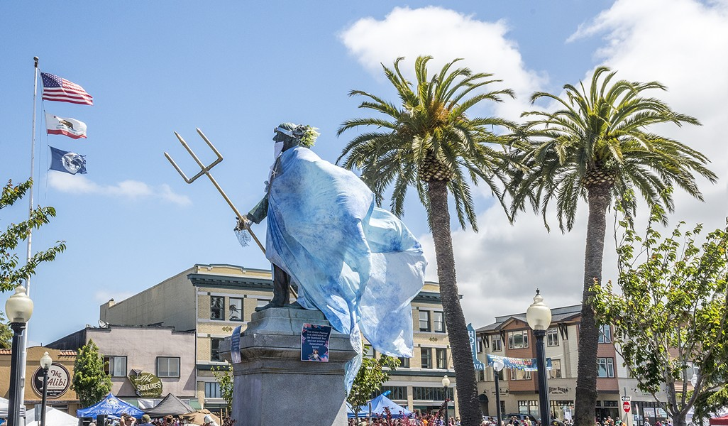 McKinley, whose fate was sealed in 2018, stands sentry over the plaza, clad in Poseidon's robes, for Oyster Fest. - MARK LARSON