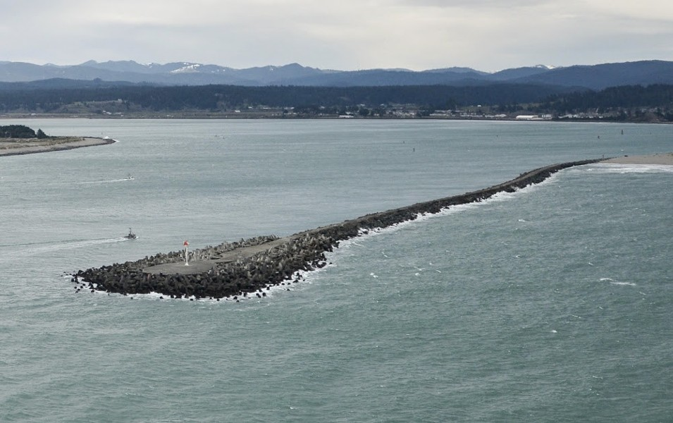 The North Jetty, where a surfer was rescued by an off-duty Coast Guard civilian employee. - USCG