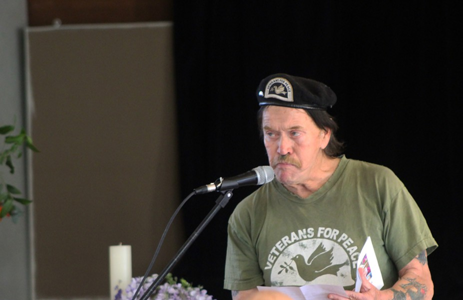 """Rob Hepburn of Veterans for Peace talks about Bill Thompson's generosity and kindness throughout his life. Hepburn said Thompson was like a """"big brother"""" to him. - PHOTO BY NATALYA ESTRADA"""