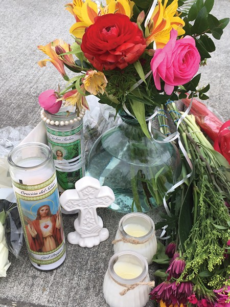 A memorial at the shooting site. - KIMBERLY WEAR