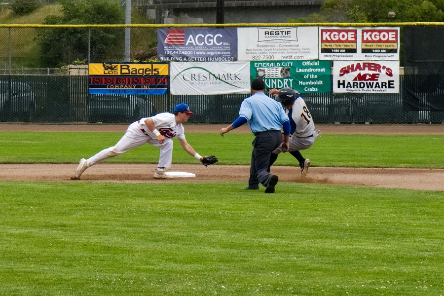 Shortstop Dom Souto lunges to make the tag at second in Sunday's game. - MATT FILAR