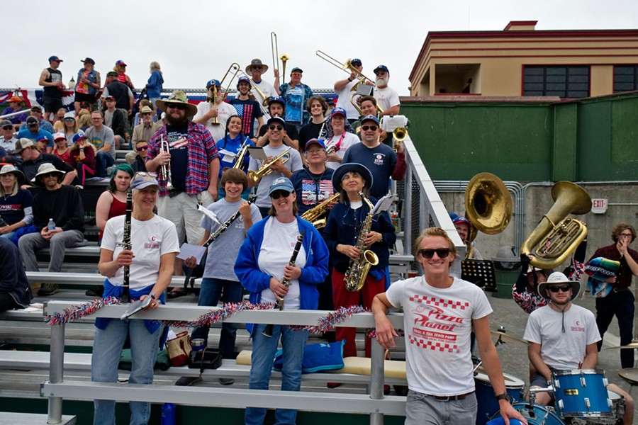 The Band cheeses before Thursday's game. - MATT FILAR