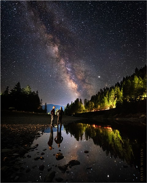 My brother Seth and I watch the world go by one summer night on the banks of the South Fork Eel River in Richardson Grove, Humboldt County, California - DAVID WILSON