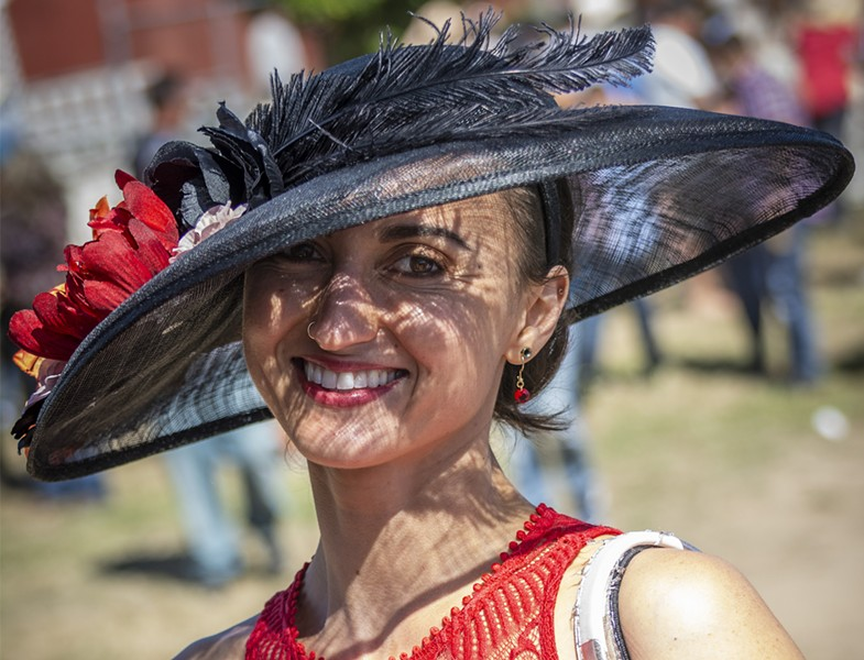 Laura Ayllon, of Loleta, put her sun hat to good use on the sunny afternoon. She placed second in the Most Glamorous category. - PHOTO BY MARK LARSON