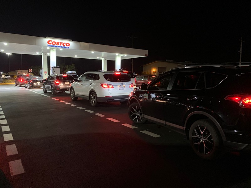 The line for gas at Costco in Eureka stretched out of the parking lot and around the block on the eve of the last shutoff. - MARK MCKENNA