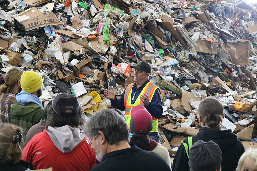 Chuck Schager speaks to a group about the new recycling changes during a tour of Recology's materials recovery facility Nov. 10.