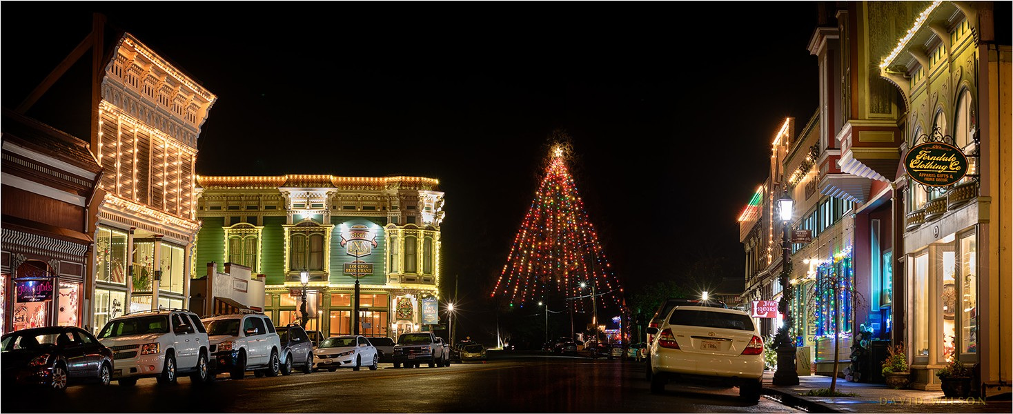 Festive lighting and Ferndale's great Christmas tree lent holiday vibes to Ferndale's Main Street. My wife kept a lookout for cars while I captured the image. December 19, 2019 in Humboldt County, California. - DAVID WILSON