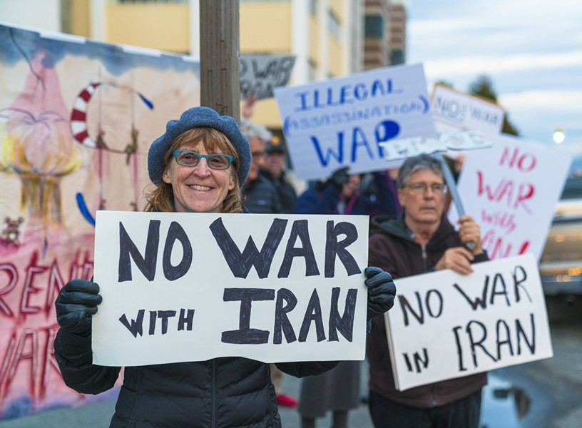 Protesters warn against war with Iran. - PHOTO BY ZACH LATHOURIS