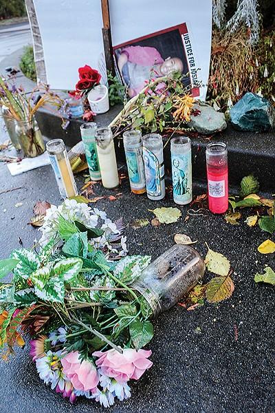 A memorial left near the Spear Avenue home where Josiah Lawson was killed. - FILE