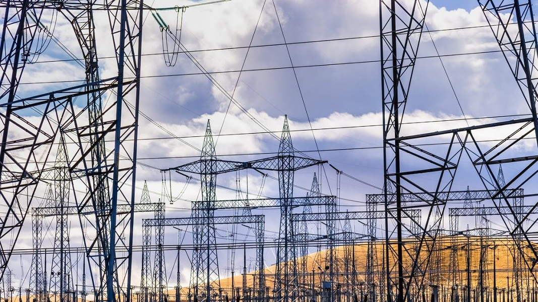 High voltage electricity towers and power lines at a substation in Central California. - ANDREI STANESCU/ISTOCK