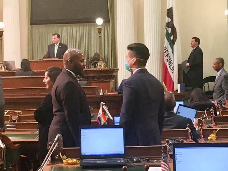 Assembylmember Evan Low wears a protective mask on the floor as lawmakers gather to address the coronavirus emergency. - LAUREL ROSENTHALL FOR CALMATTERS