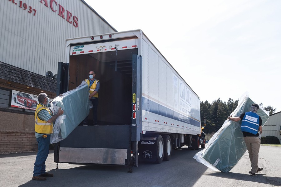 People unload supplies from a California Office of Emergency Services truck. - HUMCO COVID FACEBOOK
