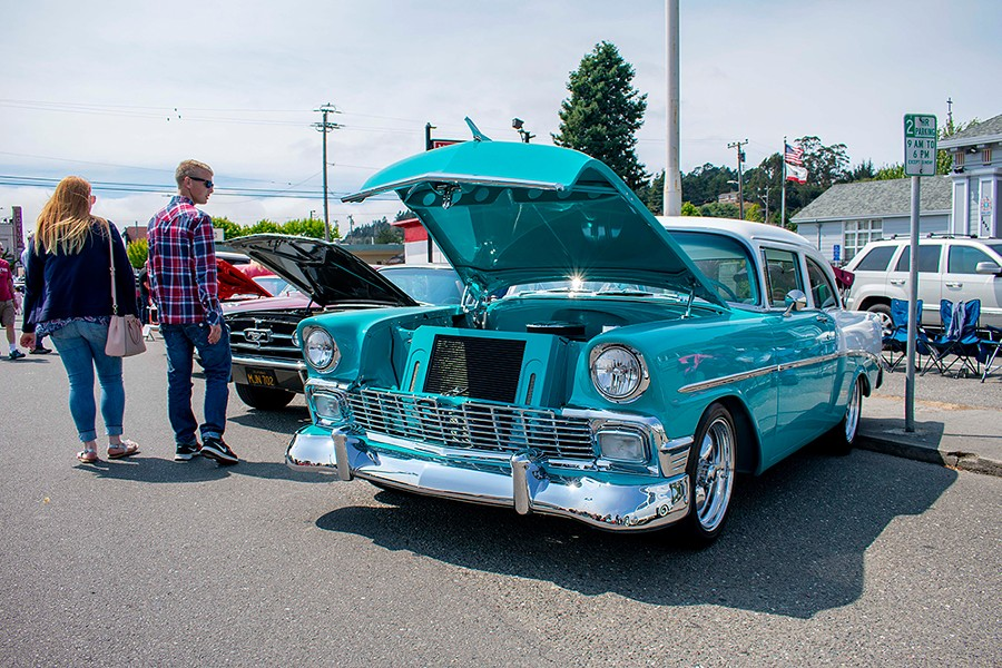 A couple stops to check out Fred Naredo's 1956 Chevy Sedal on July 28 at the Fortuna Redwood AutoXpo. - PHOTO BY MEGAN BENDER