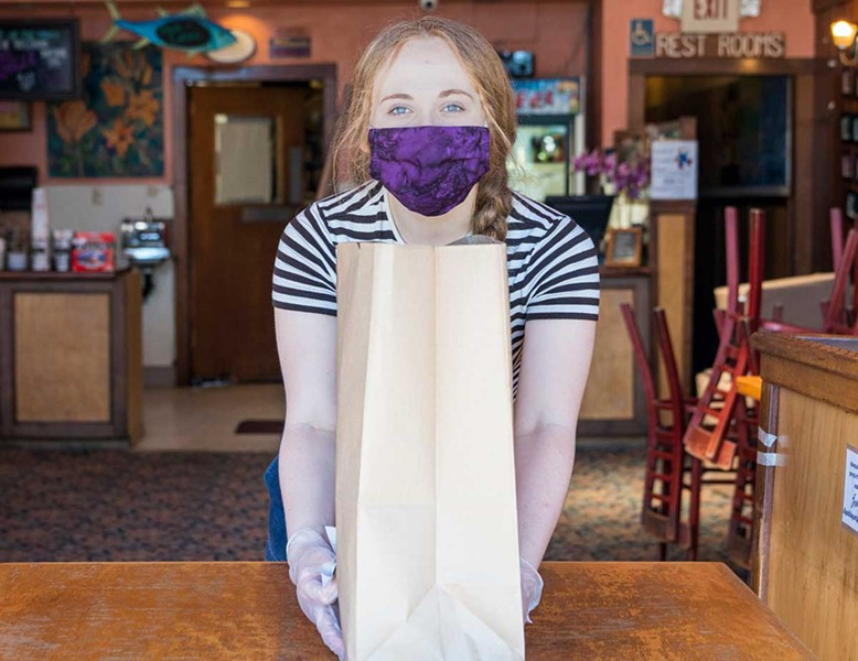 Masked, gloved and good to go at Arcata Pizza and Deli. - PHOTO BY ZACH LATHOURIS