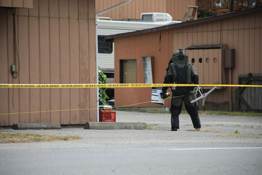 Humboldt County Sheriff's deputy wearing safety gear to examine the package. - HUMBOLDT COUNTY SHERIFF'S OFFICE