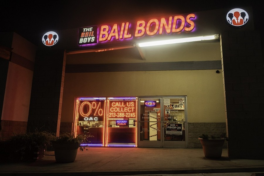 """The Bail Boys bail bonds displays a """"No on Prop 25"""" poster in downtown Los Angeles on Oct. 21, 2020. Prop. 25 would end California's current cash bail system and replace it with a three tier risk assessment system. - PHOTO BY TASH KIMMELL FOR CALMATTERS."""