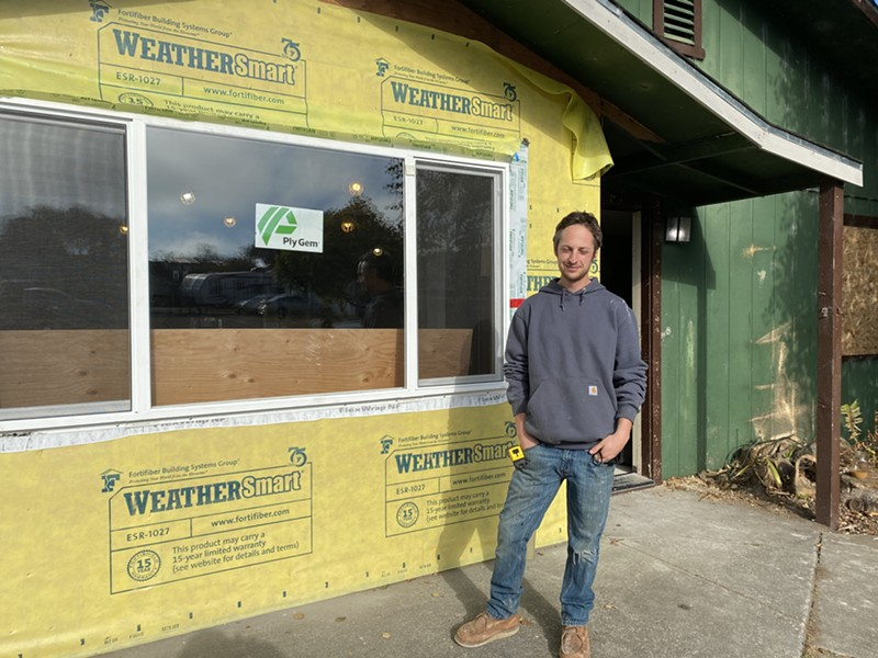 Dyland Beland stands in front of his family home, which is being repaired by College of the Redwoods students. - SUBMITTED
