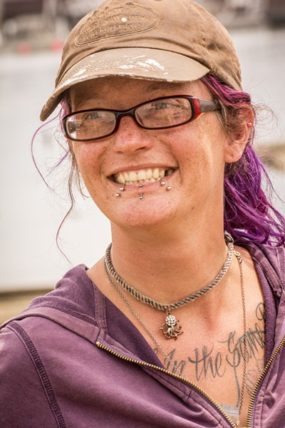 """Brekin Van Veldhuizen, of Eureka, a graduate of the Northwest School of Wooden Boat Building, led the hands-on repair work on the Golden Rule at the Zerlang & Zerlang boat yard on the Samoa peninsula. She also came up with the team's informal t-shirt motto, """"F*** War, Go Sailing."""" - MARK LARSON"""