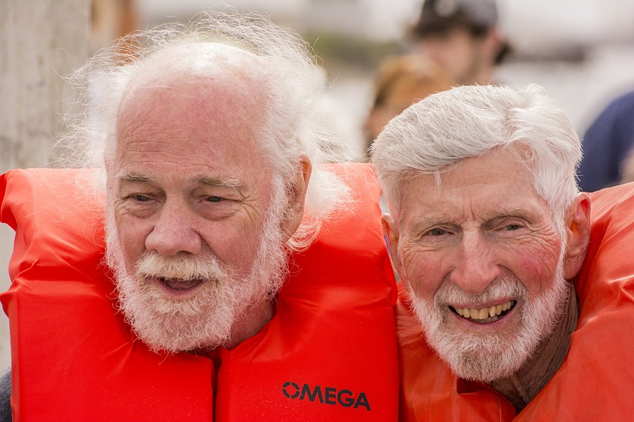 Ted Reynolds (left), family member of a crew member of the 1958 Phoenix of Hiroshima sailboat, and Orion Sherwood, the youngest of the Golden Rule's original crew, were passengers on the Golden Rule as it was towed by tug to the HSU aquatic center on Eureka's water front for public viewing. They were part of the oral history sessions during a second program about the history of the Golden Rule and other maritime peace activism. - MARK LARSON