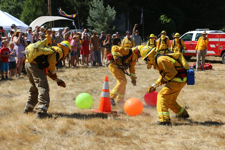 Volunteer firefighters in the first relay of the day. - JENNIFER SAVAGE