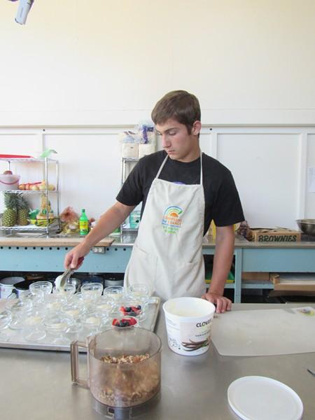 Local high-schooler John Georgia volunteers for the program, earning his food handlers certificate. - LINDA STANSBERRY