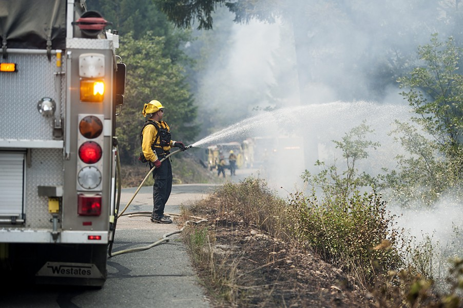 Firefighter at the Mad River fire. - MARK MCKENNA