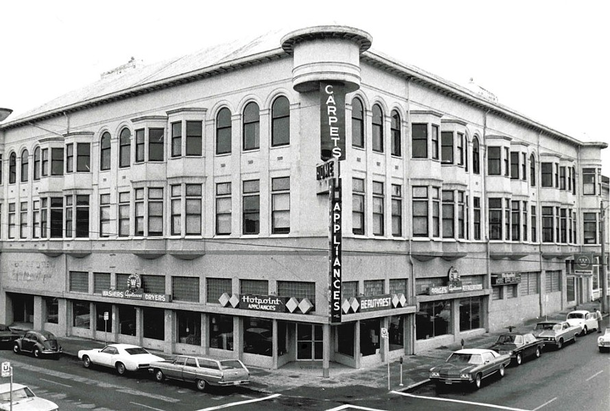 It's unclear why, but at some point near the middle of the 20th century, the ornate exterior of the Carson Block building was covered with stucco and the turret jutting out at the corner of F and Third streets was lopped off to make way for a large neon sign. - PHOTO COURTESY OF THE NORTHERN CALIFORNIA INDIAN DEVELOPMENT COUNCIL