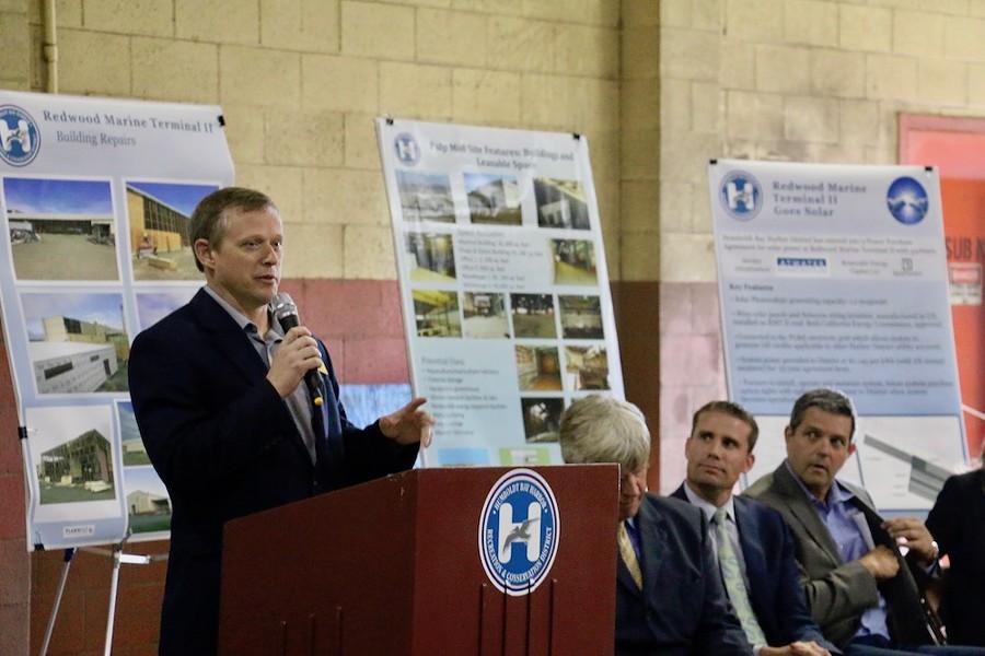 John Driscoll, the field representative for North Coast Congressman Jared Huffman, addresses the crowd. - JENNIFER SAVAGE